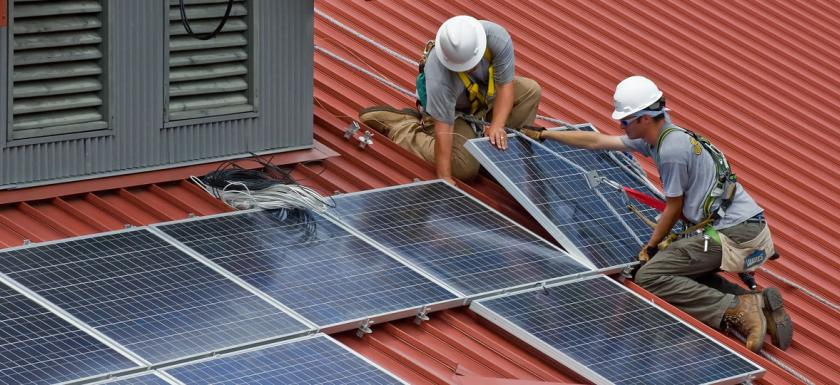energy-renewable-workers-installing-solar-rooftop-panels